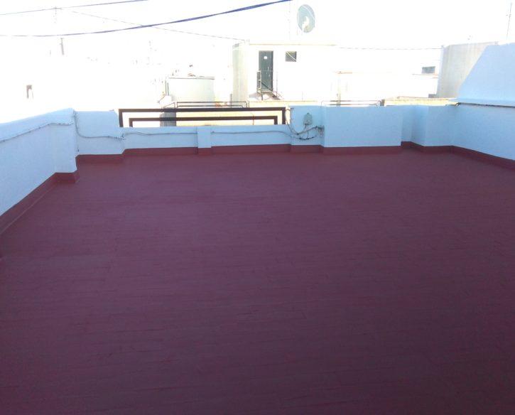 Impermeabilización de cubierta transitable y pintura de antepechos